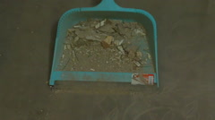 Sweeping floor with brush and dustpan Stock Footage