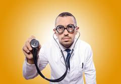 Funny doctor against the gradient Stock Photos