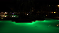 The colorful pool of Vista Sol Hotel in Punta Cana at night Stock Footage