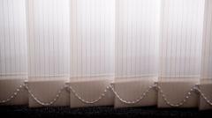 Shutter curtain against sun light on window Stock Footage