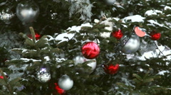 Red ball on the christmas tree during snowfall. Stock Footage