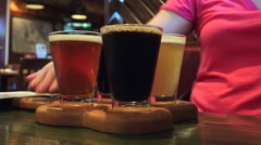 Craft Beer Sample Flight On Wooden Paddle At Bar 03 Stock Footage