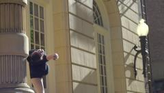 Stock Video Footage of Graceful Ballerina Practices Outside Against A Beautiful Building (Slow Motion)