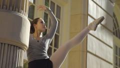 Ballerina Practices Leg Extension Outside Against A Column (Slow Motion) Stock Footage