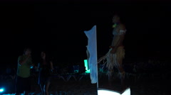 Night view of a man in a zulu warrior costume dancing on the beach in Punta Cana Stock Footage
