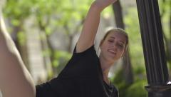 Ballerina Has Fun Improv Dancing In Park, She Uses A Lamp Post As Her Prop Stock Footage