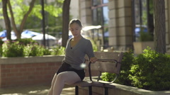 Profile Of Beautiful Ballerina Practicing A Dance On A Park Bench (Slow Motion) Stock Footage