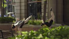 Ballerinas Practice Dance Choreography Outside In City Square (Slow Motion) Stock Footage