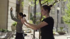 Ballerina Teaches Her Friend New Dance Choreography, They Practice In City Park Stock Footage