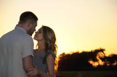romantic sensual young couple in love posing at the sunset - stock photo