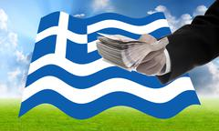 Businessman offer money to help Greece, Financial Crisis in Greece concept - stock photo