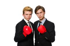 Pair of businessmen boxing on white Stock Photos