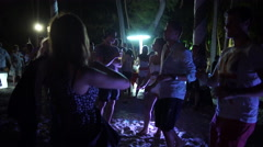 Young people dancing on the beach in Punta Cana at night Stock Footage