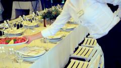 anonymous waiter serving reception in restaurant. tables waiting for guests. - stock footage
