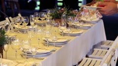 Anonymous waiter serving reception in restaurant. tables waiting for guests. Stock Footage