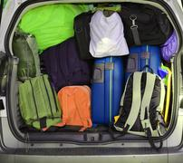 Trunk of a car overloaded with suitcases  for family travel Stock Photos
