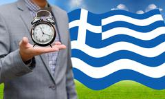 Stock Photo of Creditor show time limit to pay dept, Financial Crisis in Greece concept