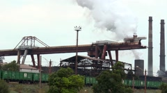 Gantry crane and rail cars at a metallurgical plant Stock Footage