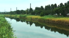 River near the industrial plant Stock Footage