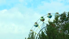 Ferris wheel on the background moving clouds - stock footage