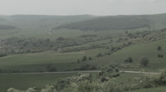 Grasslands with village in Romania -Cine Gamma- - stock footage