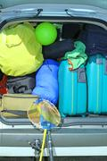suitcases and luggage in the trunk while traveling in family - stock photo