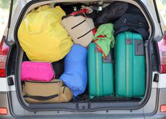 Luggage and suitcases when leaving for family summer holidays Stock Photos
