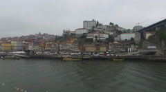 Stock Video Footage of Panoramic view of buildings on Douro River's shore, Porto