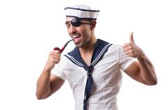 Stock Photo of Sailor with smoking pipe isolated