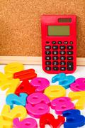 Studying maths and doing calculations as homework. - stock photo