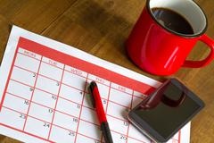 Organizing monthly activities in the calendar Stock Photos
