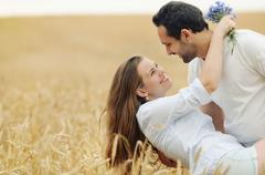sensual young couple having fun in summer field - stock photo