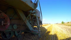 Working on the old processor bevelled wheat. Eastern Ukraine. - stock footage