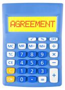 Calculator with AGREEMENT - stock photo
