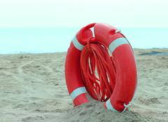Stock Photo of Orange jackets with rope to rescue swimmers in the sea