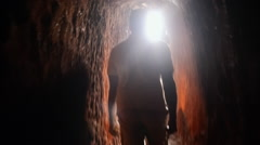 Gemstone hunter coming out of the tunnel Stock Footage