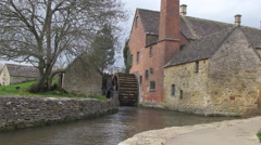 River Eye and The Old Mill in Lower Slaughter Village in the Cotswolds - stock footage