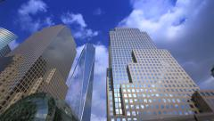 Sky and clouds mirroring into glass facades of NYC World Financial Center Stock Footage
