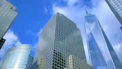 Sky and clouds reflecting over the facades of World Financial Center buildings - stock footage