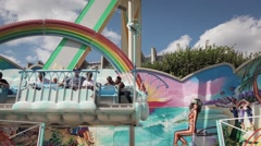 Amusement Park Pendulum ride Rainbow - 60fps - stock footage