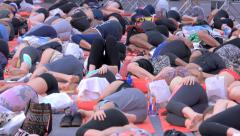 People do yoga in Times Square NYC as part of the International Day of Yoga Stock Footage