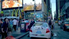 Urban NYC scenery, people and police car on Times Square Stock Footage
