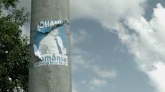 Old Poster on Lamppost in Romania -Graded- Stock Footage