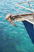 Yacht bow with anchor and turquoise ocean water Stock Photos
