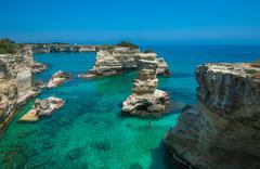Rocky beach in Puglia, Torre Sant'Andrea, Italy Stock Photos