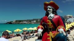 Sint Maarten 065 Maho Beach statue of a Dutch admiral in colorful scenery Stock Footage