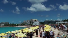 Sint Maarten 069 Maho Beach landing aircraft over yellow sun shades Stock Footage