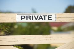 Warning sign at private property fence outdoor Stock Photos