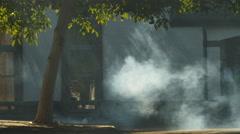 Smoke passes woman standing in doorway 4K Stock Footage