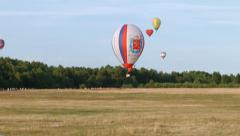 Air balloon trying go down on the airshow Stock Footage